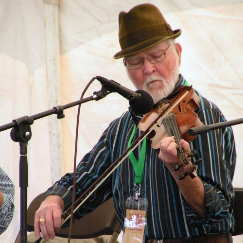 Sam Wood on stage for a fiddling workshop at the 2011 Blue Ridge Folklife Festival on the campus of Ferrum College.
