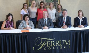 Ferrum College's Dean Angie Dahl, Provost Aimé Sposato, and President David Johns signed a memorandum of agreement with University of Pikeville's President Burton Webb and Provost Lori Werth. Pre-professional health sciences students stand behind with Associate Professor of Biology Katie Goff.