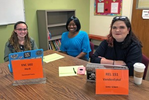 Dr. Bryant sits with two PAL tutors, Savannah Farris and Jamie Gilbert.