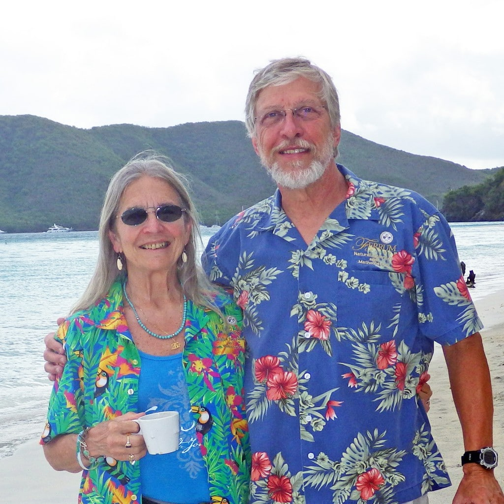 Drs. Carolyn Thomas and Bob Pohlad stand on St. John beach, Virgin Islands, in 2013.