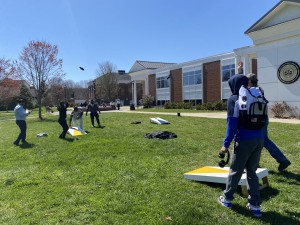 Students play corn hole outside of Franklin Hall during Student Appreciation Week 2021.
