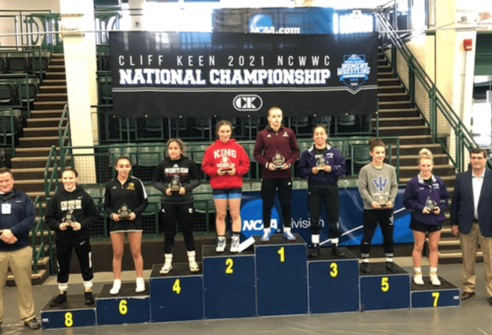 Kat Pendergrass and the rest of the women's wrestlers who won titles at Nationals.