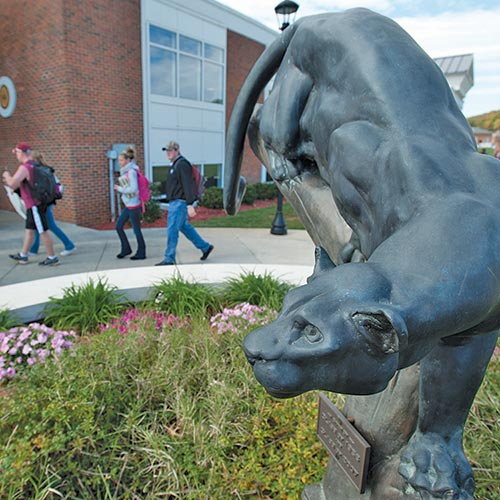 Ferrum College panther statue at Franklin Hall with students