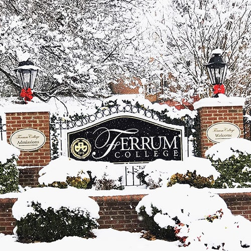 Ferrum College front gate in the snow photo by alumna Taylor Woods